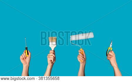House Redecoration Concept. Collage With Male Hands Holding Different Tools Over Blue Background, Fr