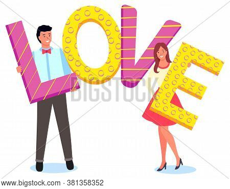 Smiling Man With Bow And Young Woman Holding Colorful Letters Of Word Love Posing For Photo Isolated