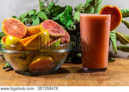 Guava Juice (psidium Guajava) And Fresh Fruits Broken In A Glass Bowl