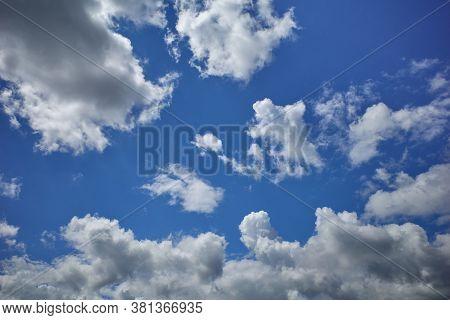 Cumulonimbus Clouds Forming A Towering Air Mass In Blue Sky