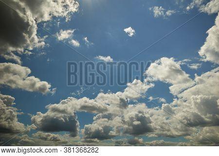 Cumulonimbus Clouds Floating Overhead In The Blue Sky