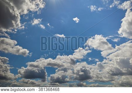 Cumulonimbus Clouds Soar In The Blue Sky
