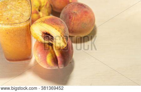 Fruits And Peach Juice (prunus Persica) On Light Background