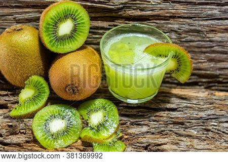Kiwi Fruits And Juice. The Kiwi Can Prevent Cardiovascular Diseases, As Its Antioxidant Activity Als