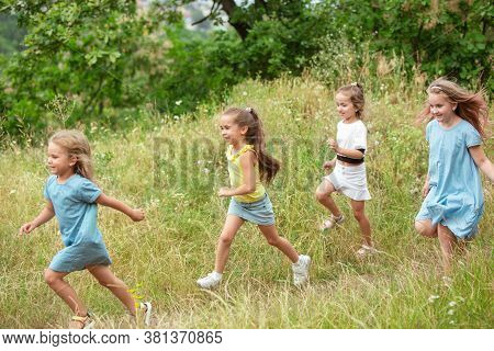 Angels. Kids, Children Running On Green Forest. Cheerful And Happy Boys And Girs Playing, Laughting,