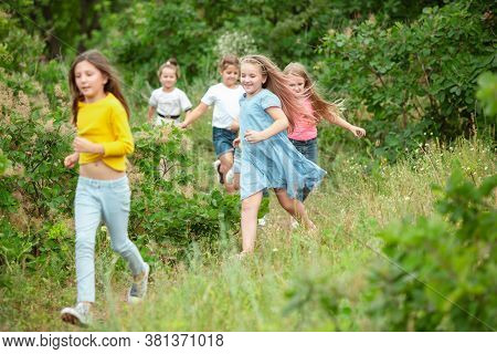 Best Time. Kids, Children Running On Green Forest. Cheerful And Happy Boys And Girs Playing, Laughti