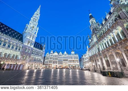 Brussels, Belgium Grand Place with the Town Hall tower at blue hour.