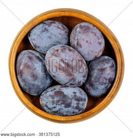 Zwetschge. Ripe European Plums In Wooden Bowl. Freestone Fruit With Purple And Violet Skin. Popular