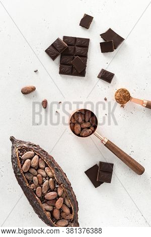 Cocoa Pod With Cocoa Beans And Pieces Of Chocolate On A White Background. Organic Food. Natural Choc