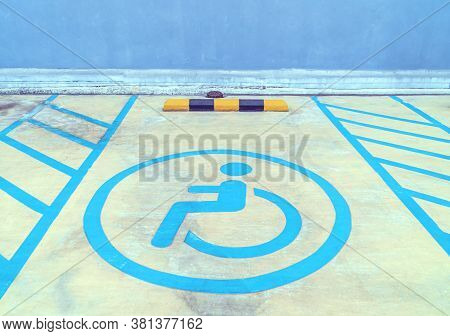 Parking Signs For The Disabled On The Parking Lot Floor, Disability Sign In Car Park In Shopping Mal