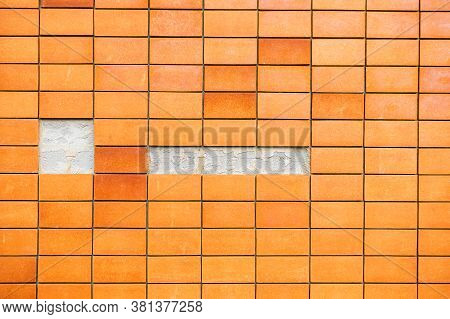 Fine Orange Burnt Tiles, Small Slabs On The Wall That Have Fallen Off Because Of The Non-standard Wo