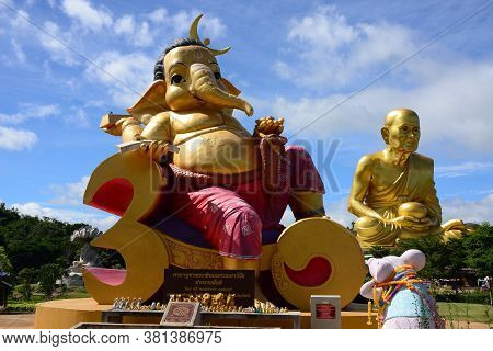 Nakhon Ratchasima, Thailand - 9 August 2020 : A Huge Monk Statue And Wonderful Park Full Of Interest