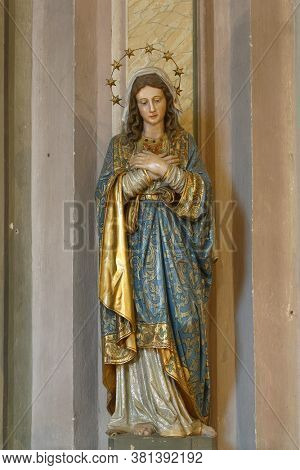 GARESNICA, CROATIA - OCTOBER 01, 2011: Immaculate Heart of Mary, statue in the parish church of the Visitation of the Blessed Virgin Mary in Garesnica, Croatia