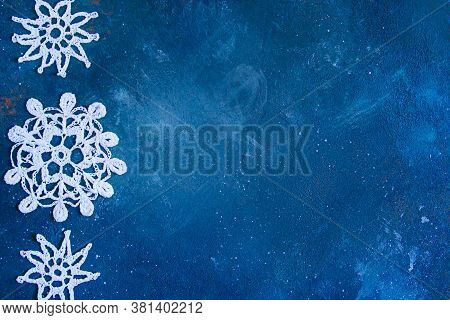 Dark Blue Frayed Texture With White Knitted Snowflakes . Christmas Background
