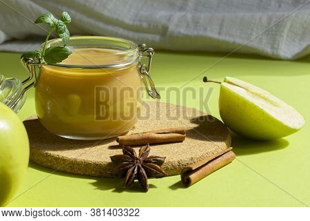 Fresh Organic Homemade Applesauce, Mousse, Sauce In A Glass Jar On A Green Background. Healthy Natur