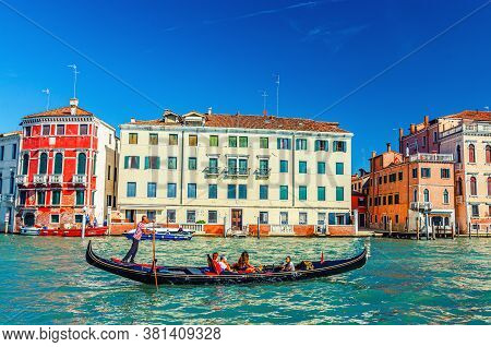 Venice, Italy, September 13, 2019: Gondolier On Gondola With Tourists People Sailing In Grand Canal