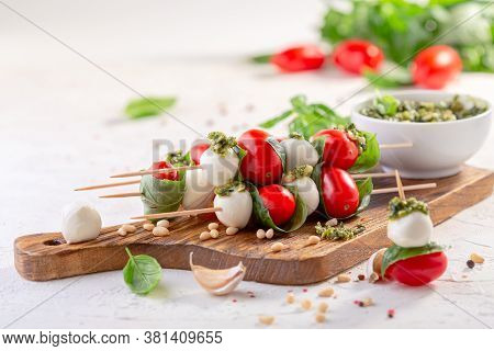 Caprese Salad-mozzarella, Basil, Cherry Tomatoes, Pesto Sauce, Skewers. Italian Homemade Food And A