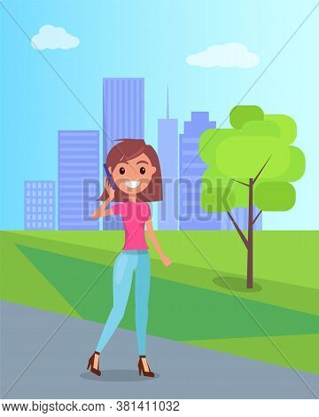 Young Girl Walks On Hight Hills In City Park And Speaks On The Smartphone. Skyscrapers Background. T
