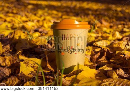 A Glass Of Coffee With The Inscription Happy Thanksgiving Day Against The Backdrop Of An Autumn Land
