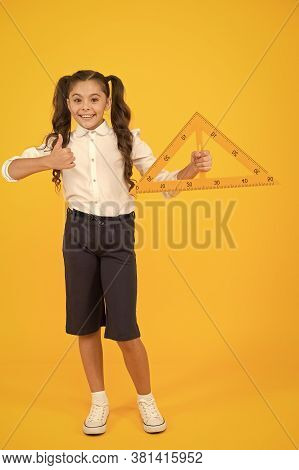 Triangle Right Angle. Knowledge Day. Schoolgirl School Uniform Hold Big Ruler Geometry School Lesson