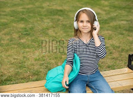 Listening To New Tunes. Small Kid Listen To Music Summer Outdoors. Listening Comprehension. Audio Le