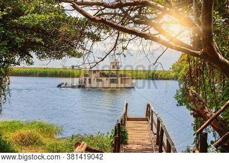 A tourist boat sailing on the Chobe river, in Okavango Delta, near Kasane