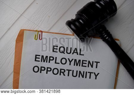 Equal Employment Opportunity Text Write On A Paperwork Isolated On Office Desk.