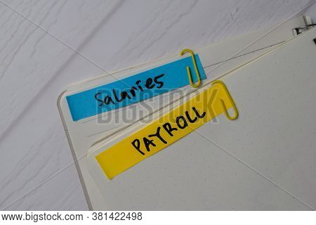 Salaries Payroll Text On Sticky Notes With Office Desk.
