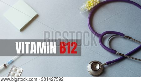 Stethoscope, Pens And Note With Text Vitamin B12 On The Doctor Uniform
