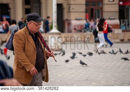 Timisoara, Romania - April 18, 2016: Man Walking On The Street. Real People.