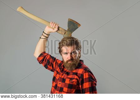 Man With Old Ax. Bearded Lumberjack. Portrait Of Man With Ax. Canadian Lumberjack. Bearded Man With