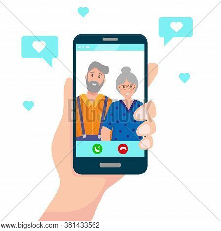 Human Hand Hold Smartphone With Happy Elderly Couple On Screen. Communication With Parents Or Grandp