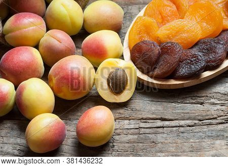 Natural Dried Apricots With Fresh Whole Ripe Apricot And Half In Bamboo Bowl On Rustic Table, Dry Ap