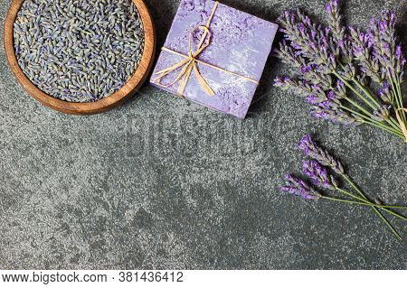 Lavender Natural Soap With Fresh Lavender Flowers And Dried Lavender Seeds On Rustic Table, Aromathe