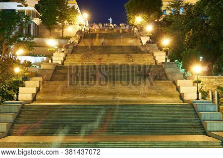 night street view of Odessa city, Ukraine, Potemkin stairs near the Primorskiy boulevard, walking people