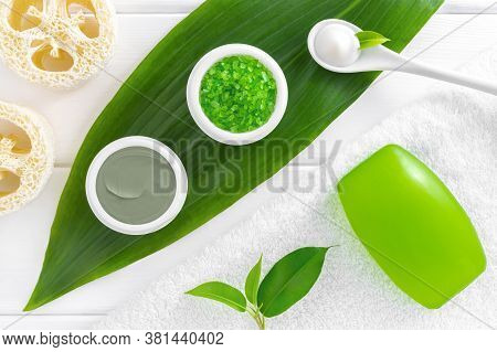 Natural Herbal Cosmetics: Sea Salt, Cosmetic Clay, Bath Soap And Cream On White Wooden Background. S