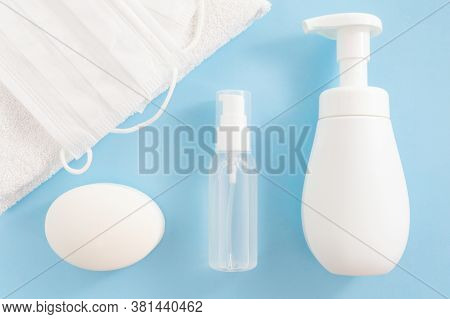 Personal Hygiene Products: Antibacterial Soap, Sanitizing Gel, Towels And Protective Face Masks On B