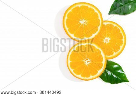 Three Slices Of Orange Fruit And Green Leaves Isolated On White Background. Creative Background, Top
