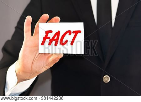 Manbusiness Card With The Word Facts In The Hand Of A Businessman.y People Holding The Red Word Fact