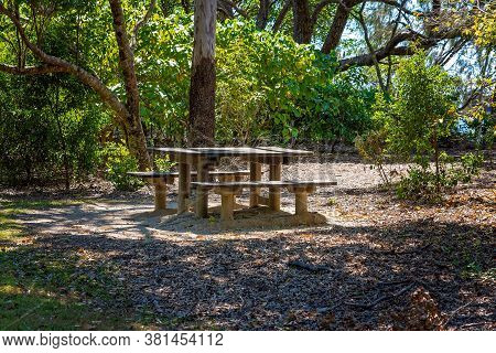 A Picnic Table And Chairs In A Beautiful Bushland Setting