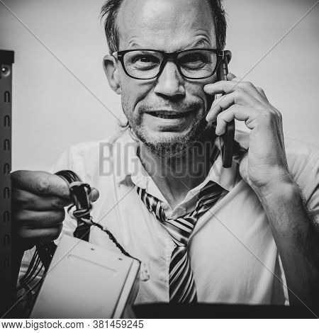 Black And White Photo Of Black And White Portrait Of Desperate Man With Broken Computer Talking With