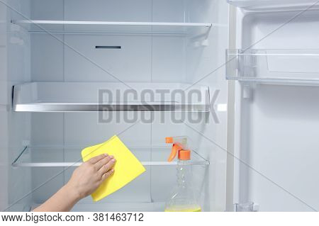 Hand Cleaning Refrigerator. Fridge Cleaning - Spray Bottle With Detergents For Washing The Fridge. H