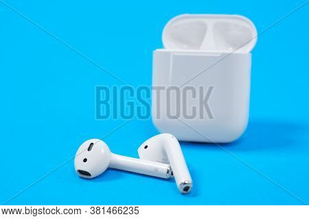 Rostov, Russia - July 06, 2020: Apple Airpods Wireless Bluetooth Headphones And Charging Case For Ap
