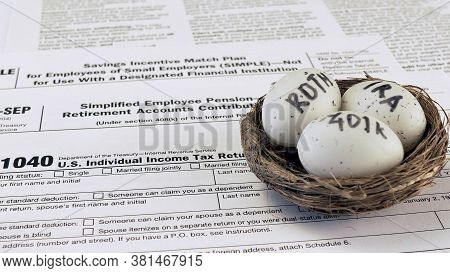 Conceptual Composition. Pension Savings. Individual Retirement Account. Three Eggs With The Inscript
