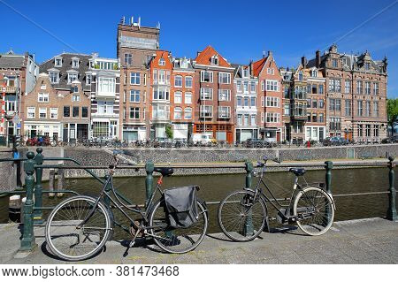 Kadijksplein, With Crooked Heritage Buildings And Bicycles In The Foreground, Located In Amsterdam C