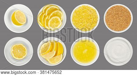 Fresh And Processed Lemons In White Glass Bowls, Isolated Over Gray. Lemon Halves, Wedges And Slices