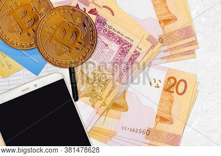 20 Belorussian Rubles Bills And Golden Bitcoins With Smartphone And Credit Cards. Cryptocurrency Inv