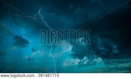 Lightning On Background Of Night Stormy Sky Before Rain. Cloudy Sky. Lightning Strike, Thunderbolt.