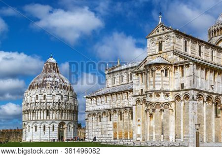 Pisa Baptistry And Cathedral Stand On Piazza Dei Miracoli In Pisa, Italy