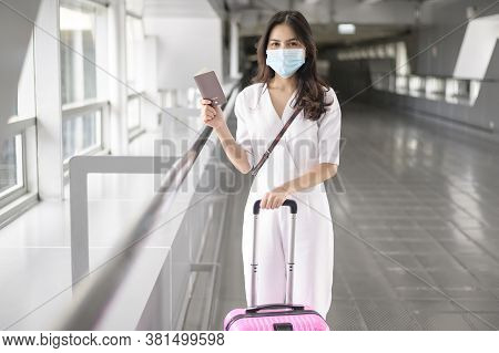 A Traveller Woman Is Wearing Protective Mask In International Airport, Travel Under Covid-19 Pandemi